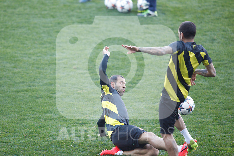 FC Barcelona´s Mascherano and Dani Alves during a training at the Vicente Calderon stadium in Madrid, Spain. Atletico de Madrid will face FC Barcelona in the second leg quarterfinal Champions League soccer match.  April 8, 2014. (ALTERPHOTOS/Victor Blanco)
