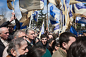 Opposition party supporters arrive at a memorial rally on the anniversary of the 1989 Soviet massacre of 20 hunger strikers outside the Parliament building in Tbilisi, Georgia.