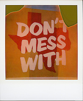 """Polaroid instant picture shot on expired Polaroid 600 film of """"Don't mess with Texas"""" mural in downtown Austin, Texas - Stock Image."""