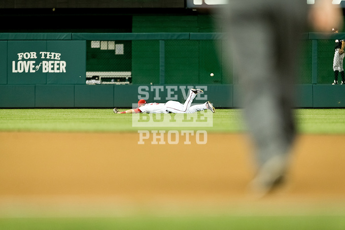 Washington Nationals outfielder Bryce Harper (34) dives and misses a fly ball during a game against the Miami Marlins at Nationals Park in Washington, DC on September 7, 2012.