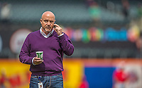 20 April 2013: Washington Nationals General Manager Mike Rizzo talks on his iPhone during batting practice prior to a game against the New York Mets at Citi Field in Flushing, NY. The Nationals rallied to defeat the Mets 7-6 and tie their 3-game series at one a piece. Mandatory Credit: Ed Wolfstein Photo *** RAW (NEF) Image File Available ***
