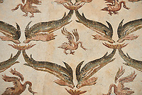 Picture of a geometric Roman mosaics design using dolphins and swans designs, from the ancient Roman city of Thysdrus. 3rd century AD, House of Dolphins. El Djem Archaeological Museum, El Djem, Tunisia.