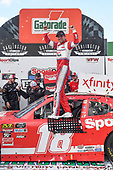#18: Denny Hamlin, Joe Gibbs Racing, Toyota Supra SportClips, celebrates winning the Sport Clips Haircuts VFW 200.
