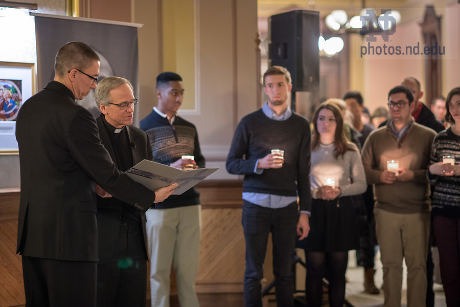 """January 15, 2018; Notre Dame President Rev. John I. Jenkins, C.S.C., speaks at a candlelight prayer service in the Main Building in observation of Martin Luther King Jr. Day. The event also marked the beginning of """"Walk the Walk"""" week, a series of events and observances to celebrate and reflect on diversity and inclusiveness. (Photo by Barbara Johnston/University of Notre Dame)"""