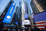 Electronic billboards display Coinbase Global Inc. signage during the company's initial public offering (IPO) outside of the Nasdaq MarketSite in New York, U.S., on Wednesday, April 14, 2021. Photograph by Michael Nagle
