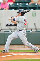 Bo Greenwell #35 of the Kinston Indians follows through on his swing against the Winston-Salem Dash at BB&T Ballpark on June 4, 2011 in Winston-Salem, North Carolina.   Photo by Brian Westerholt / Four Seam Images