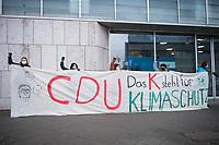 """Aktivistinnen der Klimabewegung """"Fridays for Future"""" protestierten am Freitag den 15. Januar 2021 anlaesslich des CDU Parteitags und der Wahl des Kanzlerkandidaten der CDU vor der CDU-Zentrale in Berlin-Tiergarten.<br /> Keiner der drei zur Wahl stehenden Kandidaten zum Parteivorsitz und Kanzlerkandidaten habe in der Vergangenheit gezeigt, dass er Willens sei die Klimakrise als solche anzuerkennen und auch keinen Plan, das 1,5 Grad-Ziel des Pariser Klimaabkommens umzusetzen, so Fridays for Future-Berlin.<br /> 15.1.2021, Berlin<br /> Copyright: Christian-Ditsch.de"""