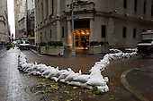 New York, New York.October 30, 2012..Sandbags cordon off the entrance to the New York Stock Exchange after a two-day shutdown, the first to be caused by weather since a blizzard in 1888.
