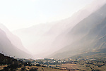 The mist begins to gather in the late afternoon over a small village in Langtang National Park, Nepal
