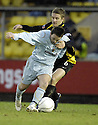 02/02/2008    Copyright Pic: James Stewart.File Name : sct_jspa05_livingston_v_partick_th.LEE MAKEL PULLS BACK STEVEN MURRAY.James Stewart Photo Agency 19 Carronlea Drive, Falkirk. FK2 8DN      Vat Reg No. 607 6932 25.Studio      : +44 (0)1324 611191 .Mobile      : +44 (0)7721 416997.E-mail  :  jim@jspa.co.uk.If you require further information then contact Jim Stewart on any of the numbers above........