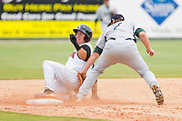 Kevin Dubler #27 of the Kannapolis Intimidators slides into third base ahead of the tag by Michael Kvasnicka #7 of the Lexington Legends at Fieldcrest Cannon Stadium on May 11, 2011 in Kannapolis, North Carolina.   Photo by Brian Westerholt / Four Seam Images