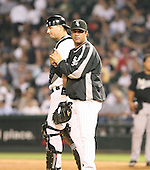 Ozzie Guillen and A.J. Pierzynski of the Chicago White Sox vs. the Florida Marlins: June 19th, 2007 at Wrigley Field in Chicago, IL.  Photo copyright Mike Janes Photography 2007.