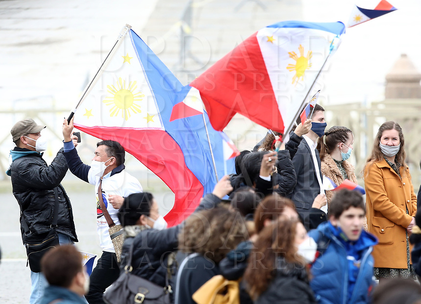 Faithful, wearing face masks to curb the spread of COVID-19, hold a Philippines flag as Pope Francis recites the Angelus noon prayer from the window of his studio overlooking St.Peter's Square, at the Vatican, Sunday, March 14, 2021.UPDATE IMAGES PRESS/Isabella Bonotto<br /> <br /> STRICTLY ONLY FOR EDITORIAL USE