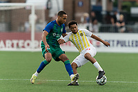HARTFORD, CT - AUGUST 17: Zeiko Lewis #10 of Charleston Battery dribbles as Derek Dodson #14 of Hartford Athletic defends during a game between Charleston Battery and Hartford Athletic at Dillon Stadium on August 17, 2021 in Hartford, Connecticut.