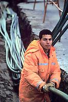 - yard for optical fiber wiring, North African worker....- cantiere per il cablaggio in fibra ottica, operaio nordafricano