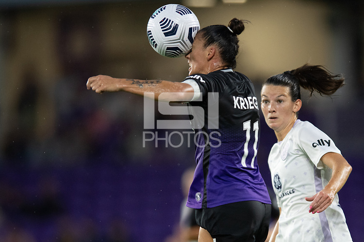 ORLANDO, FL - SEPTEMBER 11: Ali Krieger #11 of the Orlando Pride heads the ball during a game between Racing Louisville FC and Orlando Pride at Exploria Stadium on September 11, 2021 in Orlando, Florida.