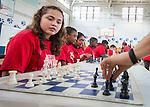 Chess grandmaster Susan Polgar plays students at Ryan Middle School, September 15, 2014.