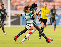 HOUSTON, TX - JUNE 13: Alicia Correia #3 of Portugal fights for the ball with Ijeoma Okonronkwo #12 of Nigeria dribbles the ball during a game between Nigeria and Portugal at BBVA Stadium on June 13, 2021 in Houston, Texas.