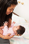 7 week old newborn baby girl held by mother, interaction, listening as she talks