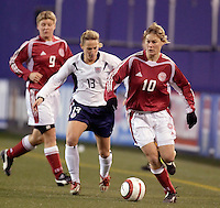 """Denmark's Anne Dot Eggers keeps the ball away from Kristine Lilly of the USA. The US Women's National Team tied the Denmark Women's National Team 1 to 1 during game 8 of the 10 game the """"Fan Celebration Tour"""" at Giant's Stadium, East Rutherford, NJ, on Wednesday, November 3, 2004.."""