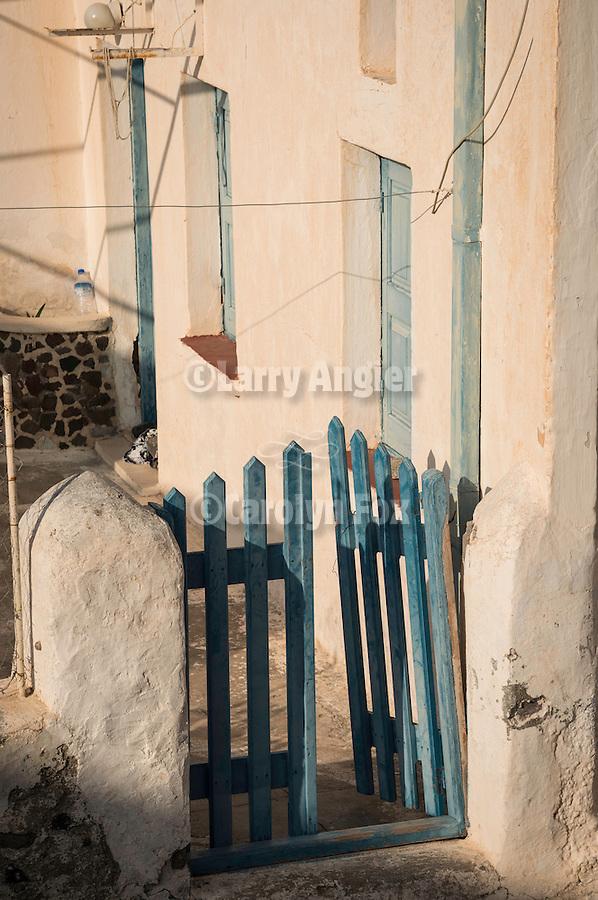 Fade blue gate, Akrotiri, Santorini, Greece