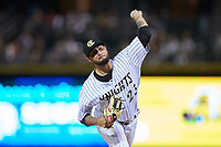Charlotte Knights relief pitcher Jordan Guerrero (23) in action against the Gwinnett Braves at BB&T BallPark on July 12, 2019 in Charlotte, North Carolina. The Stripers defeated the Knights 9-3. (Brian Westerholt/Four Seam Images)