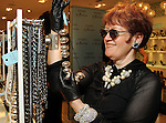 Joann Klein looks at jewelry at the Young at Heart party at the Guess by Marciano store at the Galleria  Wednesday March 24,2010. (Dave Rossman Photo)