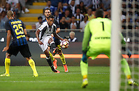 Calcio, Serie A: Inter vs Juventus. Milano, stadio San Siro, 18 settembre 2016.<br /> Juventus' Alex Sandro, center, kicks the ball during the Italian Serie A football match between FC Inter and Juventus at Milan's San Siro stadium, 18 September 2016.<br /> UPDATE IMAGES PRESS/Isabella Bonotto