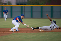 AZL Cubs 2 second baseman Levi Jordan (4) prepares to apply the tag to Bryce Bush (61) on a stolen base attempt during an Arizona League game against the AZL White Sox at Sloan Park on July 13, 2018 in Mesa, Arizona. The AZL Cubs 2 defeated the AZL White Sox 6-4. (Zachary Lucy/Four Seam Images)