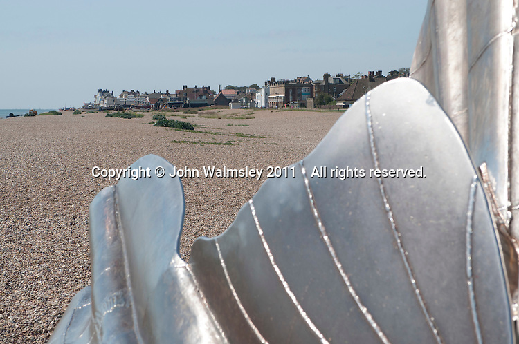 """""""Scallop"""" a sculpture to celebrate Benjamin Britten by Maggie Hambling.  Made specifically for this site on the Suffolk coast which inspired so much of Britten's music.  The phrase, """"I hear those voices that will not be drowned"""" (pierced through the steel against the sky), is taken from Britten's opera """"Peter Grimes"""", which was itself based on a work by the Aldeburgh poet, George Crabbe.  Looking towards Aldeburgh."""