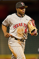 Texas Tech Red Raiders center fielder Barrett Barnes #8 jogs off the field at the end of an inning during the game against the Rice Owls at Minute Maid Park on March 3, 2012 in Houston, Texas.  The Owls defeated the Red Raiders 6-2.  Brian Westerholt / Four Seam Images