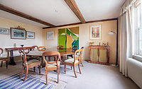 BNPS.co.uk (01202) 558833.<br /> Pic: CarterJonas/BNPS<br /> <br /> Pictured: Dining room. <br /> <br /> The former family home of Lord of the Flies author William Golding has gone on sale for £1m.<br /> <br /> The Grade II Listed cottage on a green in Marlborough is said to have inspired some of the Nobel Prize winning writer's work.<br /> <br /> His parents Alec, a teacher, and Mildred, a suffragette, bought the house and moved there in 1905, when Mr Golding obtained a job at the town's grammar school.<br /> <br /> Sir William was born in 1911 and he and his brother lived in the property and its location influenced his writing. He wrote of the property: 'Our house was on the green, that close like square, tilted south'.