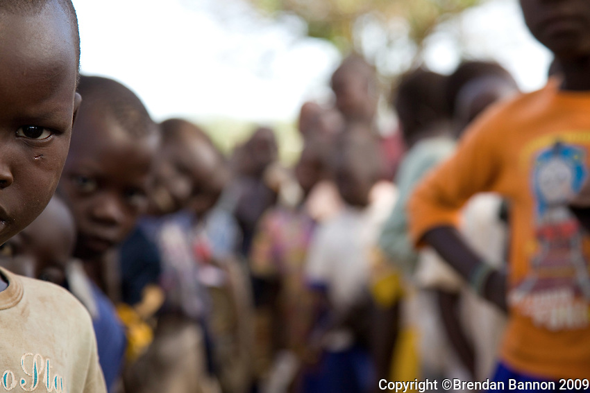 Children wait in line to be  tested for sleeping sickness at a refugee camp in Nyori, South Sudan. These congolese children fled thier villages after attacks by the LRA (Lords Resistence Army). Over 6,000 refugees live in this camp.