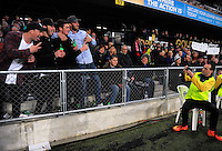 A security guard takes a photo of fans during the Steinlager Series rugby union match between the New Zealand All Blacks and Wales at Forsyth Barr Stadium, Wellington, New Zealand on Saturday, 25 June 2016. Photo: Dave Lintott / lintottphoto.co.nz