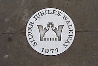 Queen's Silver Jubilee Walkway marker on the South Bank of the Thames, London, UK