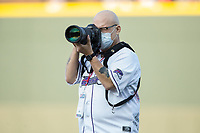 Winston-Salem Dash team photographer Jody Stewart hard at work prior to the game against the Buies Creek Astros at BB&T Ballpark on April 13, 2017 in Winston-Salem, North Carolina.  The Dash defeated the Astros 7-1.  (Brian Westerholt/Four Seam Images)