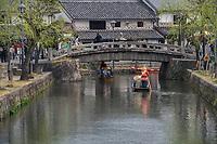 Japan, Okayama Prefecture, Kurashiki. Small tour boat on the river.