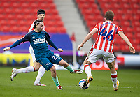 20th March 2021; Bet365 Stadium, Stoke, Staffordshire, England; English Football League Championship Football, Stoke City versus Derby County; Patrick Roberts of Derby County tackles Rhys Norrington-Davies of Stoke City