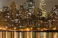 Upper East Side Skyline and East River Illuminated on a Cloudy Night, New York City, New York State, USA