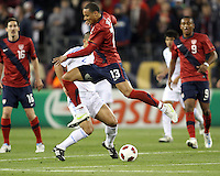 Jermaine Jones(13) of the USA MNT jumps past Dano Anastacio Veron(2) of Paraguay during an international friendly match at LP Field, in Nashville, TN. on March 29, 2011. Paraguay won 1-0.