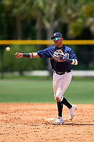 FCL Tigers East second baseman Yoneiry Acevedo (4) throws to first base during a game against the FCL Yankees on June 28, 2021 at Tigertown in Lakeland, Florida.  (Mike Janes/Four Seam Images)