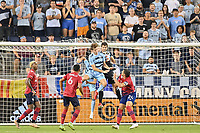 KANSAS CITY, KS - JULY 31: Jimmy Maurer #20 FC Dallas catch s the ball despite the challenge from Wilson Harris #96 Sporting KC during a game between FC Dallas and Sporting Kansas City at Children's Mercy Park on July 31, 2021 in Kansas City, Kansas.