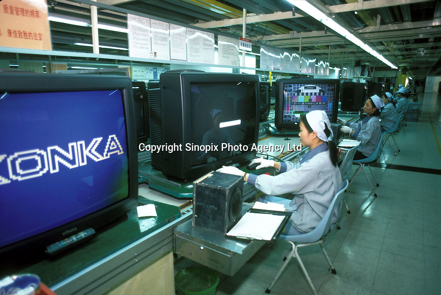 Workers assemble TVs at a factory in the Shenzhen Science Industrial Park, Shenzhen, China. Konka is one of the biggest manufacturers of TVs in China and the world.  .