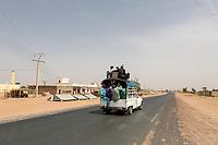 Senegal, Touba.  Vehicular Safety.  No Seatbelts; no Seats!  Inter-city Transport Leaving Touba.