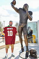 Adam Stanley pose next to statue of fromer Baylor and NFL Washington Redskins quarterback Robert Griffin III before NCAA Football at McLean Stadium, Sunday, August 31, 2014 in Waco, Tex. (Mo Khursheed/TFV Media via AP Images)