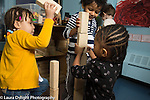 Education Preschool 3 year olds group of two girls and a boy building with blocks together