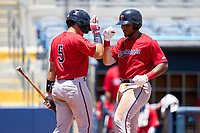 FCL Twins LaRon Smith (25) fist bumps Yonardy Soto (5) after hitting a home run during a game against the FCL Rays on July 20, 2021 at Charlotte Sports Park in Port Charlotte, Florida.  (Mike Janes/Four Seam Images)