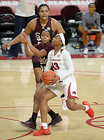 Arkansas guard Makayla Daniels (43) drives to the basket Thursday, Feb. 11, 2021, as Mississippi State guard Caterrion Thompson (left) defends during the first half of play in Bud Walton Arena. Visit nwaonline.com/210212Daily/ for today's photo gallery. <br /> (NWA Democrat-Gazette/Andy Shupe)