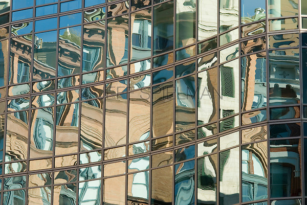 Reflections of older buildings in the window of a modern luxury apartment building, Astor Place, in the East Village neighborhood of Lower Manhattan.