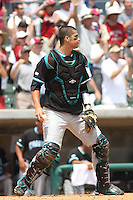 The Coastal Carolina University Chanticleers catcher Jose Iglacias #25 awaiting a throw at the plate during the 2nd and deciding game of the NCAA Super Regional vs. the University of South Carolina Gamecocks on June 13, 2010 at BB&T Coastal Field in Myrtle Beach, SC.  The Gamecocks defeated Coastal Carolina 10-9 to advance to the 2010 NCAA College World Series in Omaha, Nebraska. Photo By Robert Gurganus/Four Seam Images